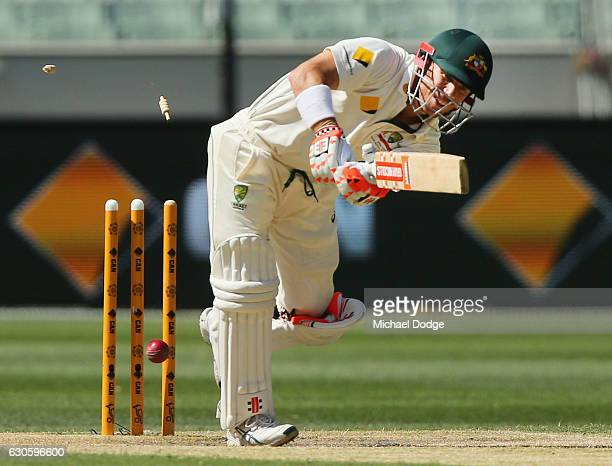 David Warner of Australia is bowled off a noball by Wahab Riaz of India during day three of the Second Test match between Australia and Pakistan at...