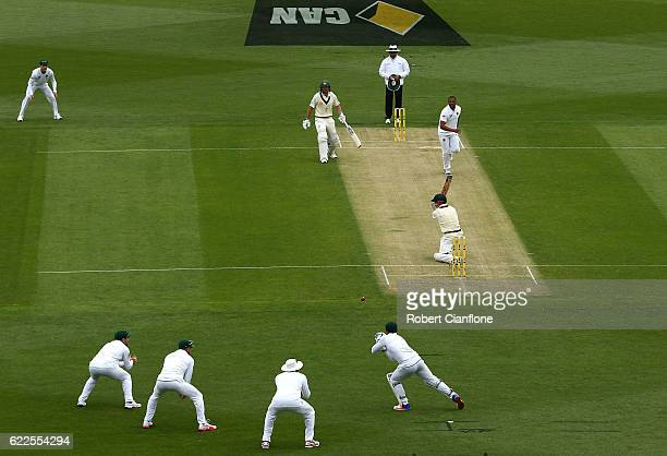David Warner of Australia is caught by Quinton de Kock of South Africa during day one of the Second Test match between Australia and South Africa at...