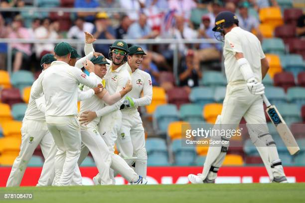 David Warner of Australia is congratulated after catching out Jake Ball of England off a delivery by team mate Mitchell Starc of Australia during day...