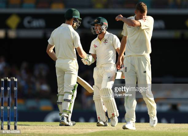 David Warner of Australia is congratulated by Cameron Bancroft of Australia after reaching his half century as Jake Ball of England walks back to his...