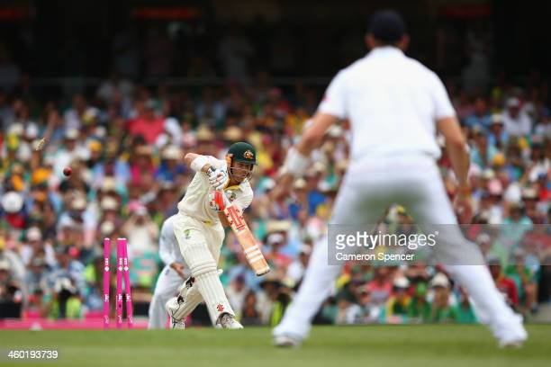 David Warner of Australia is dismissed by Stuart Broad of England during day one of the Fifth Ashes Test match between Australia and England at...
