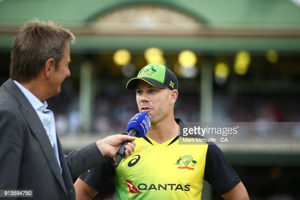 David Warner of Australia is interviewed after the coin toss before game one of the International Twenty20 series between Australia and New Zealand...