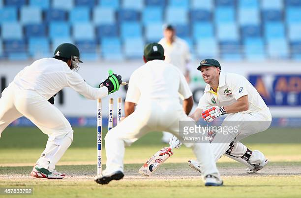 David Warner of Australia is stumped by Sarfraz Ahmed from a ball bowled by Zulfiqar Babar Pakistan during day four of the First Test between...