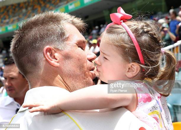 David Warner of Australia kisses his daughter Ivy after Australia hit the winning runs during day five of the First Test Match of the 2017/18 Ashes...