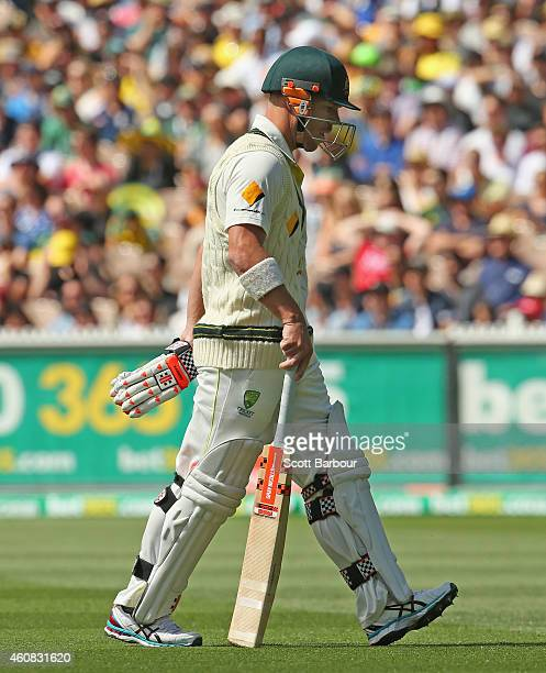 David Warner of Australia leaves the field after being dismissed during day one of the Third Test match between Australia and India at Melbourne...