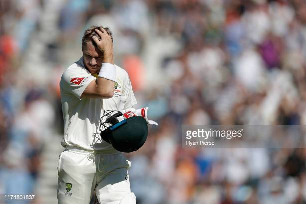 David Warner of Australia looks dejected after being dismissed by Stuart Broad of England during day four of the 5th Specsavers Ashes Test between...