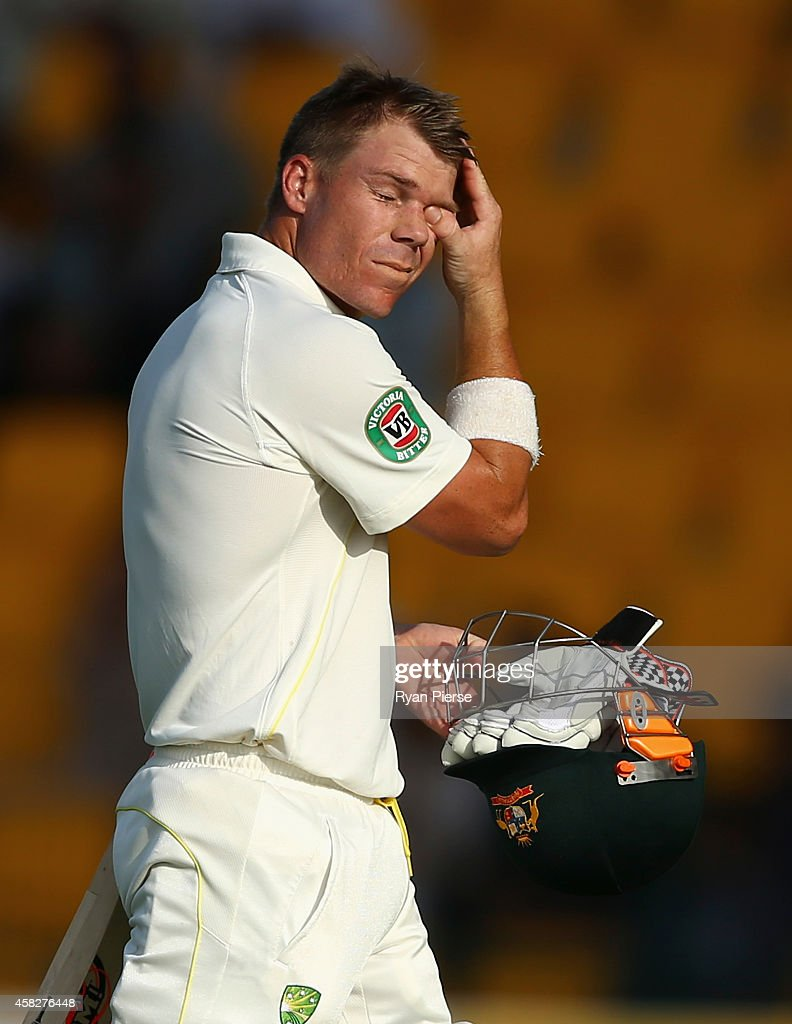 David Warner of Australia looks dejected after being dismissed by Mohammad Hafeez of Pakistan during Day Four of the Second Test between Pakistan and Australia at Sheikh Zayed Stadium on November 2, 2014 in Abu Dhabi, United Arab Emirates.