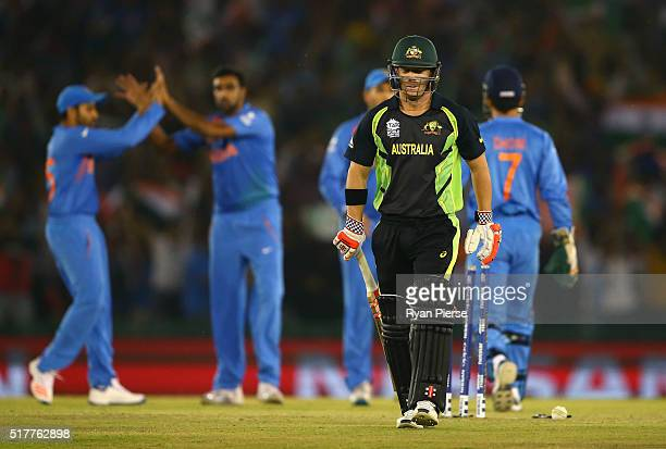 David Warner of Australia looks dejected after being dismissed by Ravichandran Ashwin of India during the ICC WT20 India Group 2 match between India...
