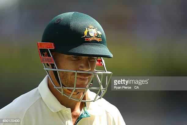 David Warner of Australia looks dejected after being dismissed by Mohammad Amir of Pakistan during day three of the First Test match between...