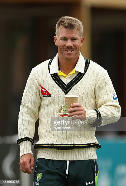 David Warner of Australia looks on after retiring after scoring a century during day one of the Tour Match between Derbyshire and Australia at The...
