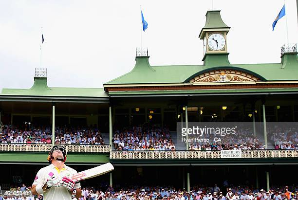 David Warner of Australia looks to the sky as he walks out to bat during day one of the Fourth Test match between Australia and India at Sydney...
