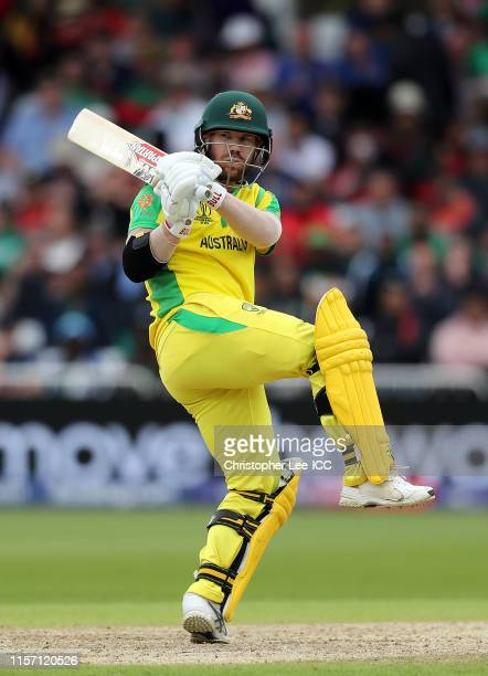 David Warner of Australia plays a shot during the Group Stage match of the ICC Cricket World Cup 2019 between Australia and Bangladesh at Trent...