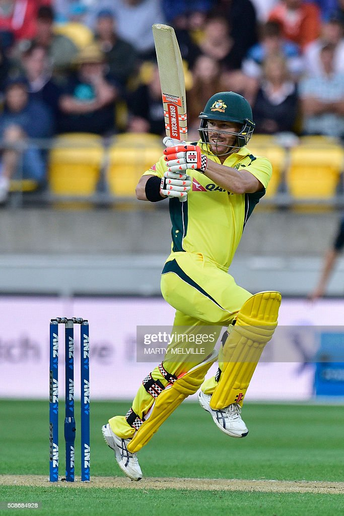 David Warner of Australia plays a shot during the second one-day international cricket match between New Zealand and Australia at Westpac Stadium in Wellington on February 6, 2016. AFP PHOTO / MARTY MELVILLE / AFP / Marty Melville