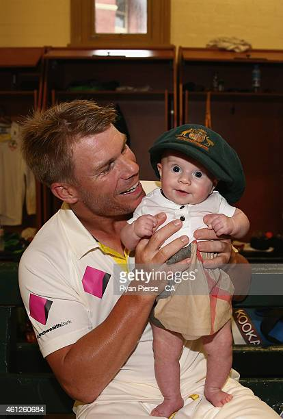 David Warner of Australia poses with his daughter Ivy in the change rooms after day five of the Fourth Test match between Australia and India at...