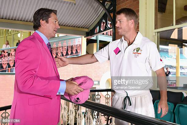 David Warner of Australia presents former Australian bowler Glenn McGrath with his Pink Cap on Jane McGrath Day during day three of the third Test...