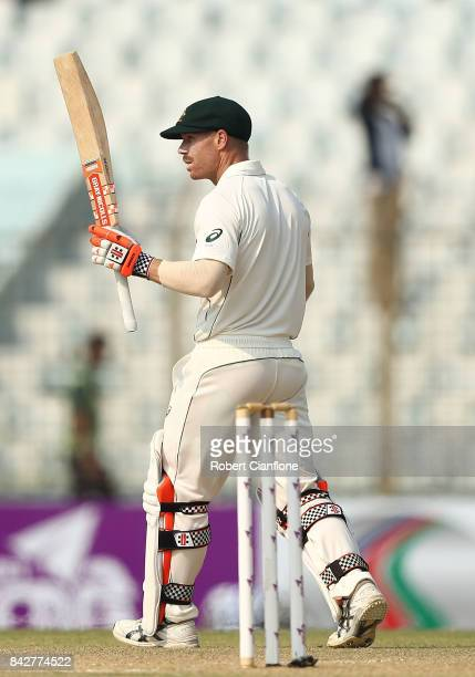 David Warner of Australia raises his bat after making his half century during day two of the Second Test match between Bangladesh and Australia at...