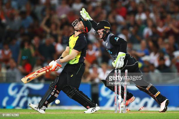 David Warner of Australia reacts after being bowled out by Ish Sodhi of the Black Caps during the International Twenty20 match between New Zealand...