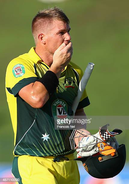 David Warner of Australia reacts after being dismissed during the third match of the one day international series between Australia and Pakistan at...