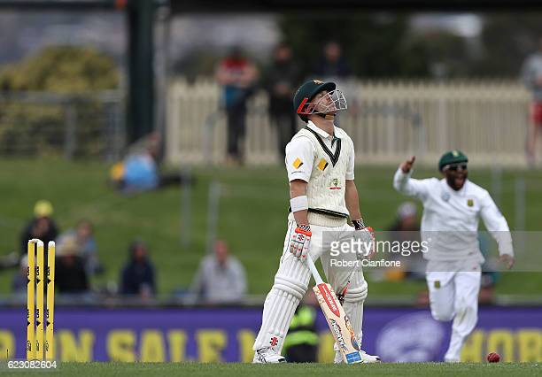 David Warner of Australia reacts after he was bolwed by Kyle Abbott of South Africa during day three of the Second Test match between Australia and...