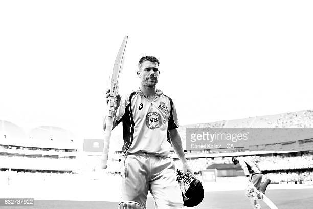 David Warner of Australia reacts as he walks from the field after being caught during game five of the One Day International series between Australia...