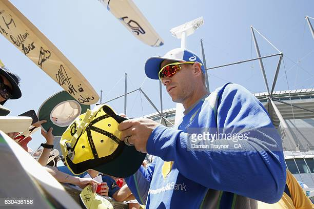 David Warner of Australia signs autographs during Family Day At The 'G' at Melbourne Cricket Ground on December 23, 2016 in Melbourne, Australia.