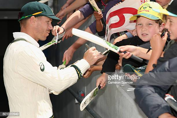 David Warner of Australia signs autographs for fans at the conclusion of the match during day three of the First Test match between Australia and the...