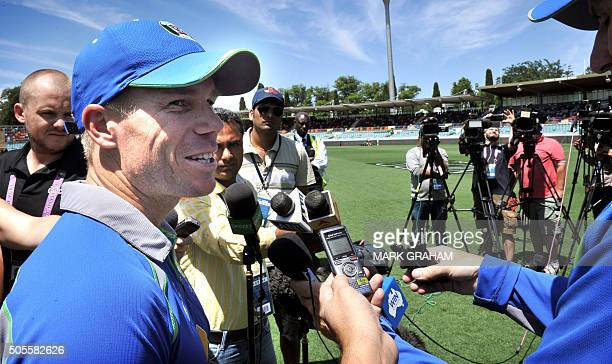 David Warner of Australia speaks to the media as he takes part in a team training session at the Manuka Oval in Canberra on January 19 2016 ahead of...
