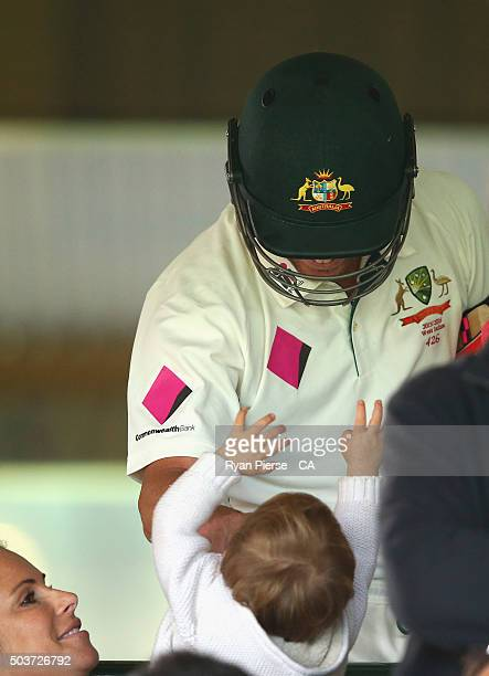 David Warner of Australia speaks with his wife Candice and daughter Ivy as he walks out to bat during day five of the third Test match between...