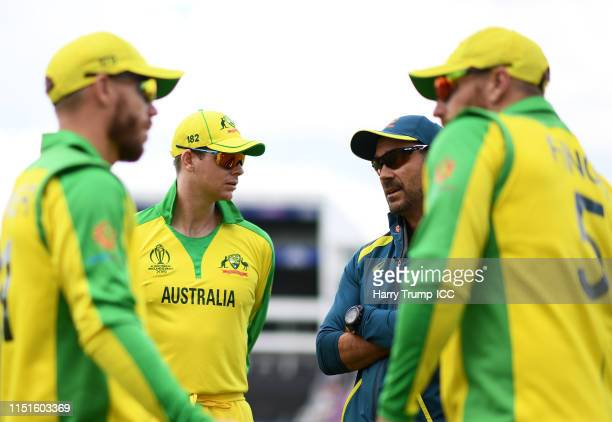 David Warner of Australia Steve Smith of Australia Justin Langer Head Coach of Australia and Aaron Finch Captain of Australia chat during the ICC...