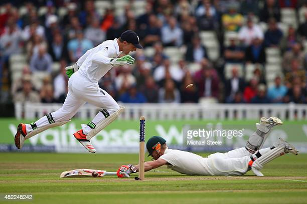 David Warner of Australia survives a run out after a direct hit from Stuart Broad of England during day one of the 3rd Investec Ashes Test match...