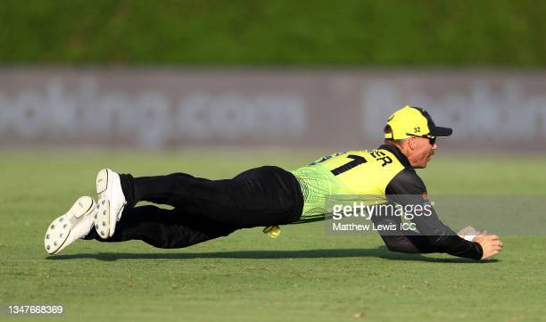 David Warner of Australia takes a catch to dismiss KL Rahul of India during the India and Australia warm Up Match prior to the ICC Men's T20 World...