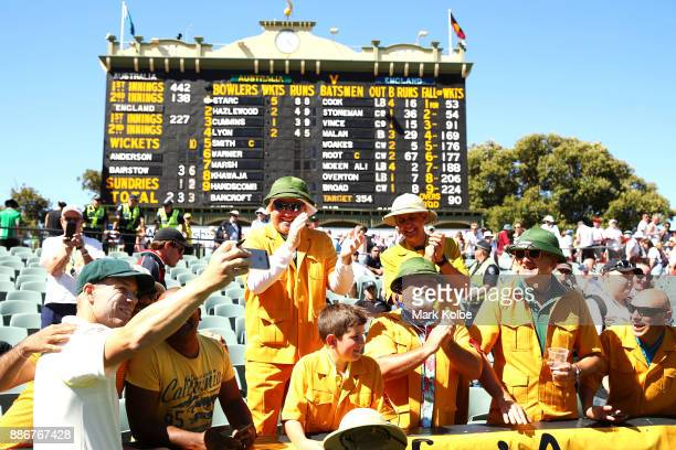David Warner of Australia takes a selfie with members of the crowd after day five of the Second Test match during the 2017/18 Ashes Series between...