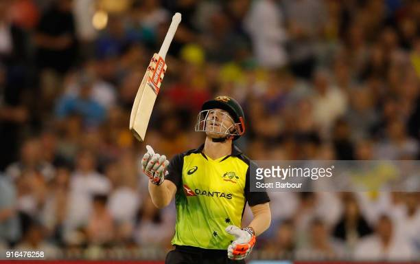 David Warner of Australia throws his bat in the air after being dismissed during game two of the International Twenty20 series between Australia and...