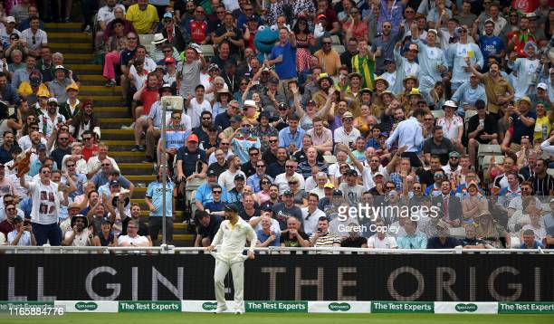 David Warner of Australia turns out his pockets as he fields in front of the Hollies Stand during day three of the 1st Specsavers Ashes Test between...