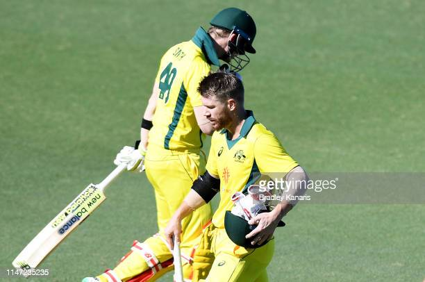 David Warner of Australia walks from the field after being dismissed as Steve Smith is seen walking in to bat during the Cricket World Cup One Day...