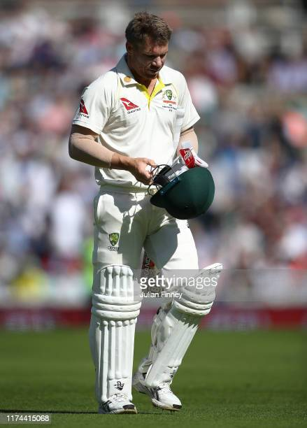 David Warner of Australia walks off after being caught behind after a review by England off the bowling of Jofra Archer of England during day two of...