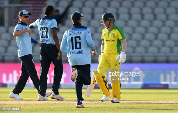 David Warner of Australia walks off as Jofra Archer celebrates his wicket with teammates during the 2nd Royal London One Day International Series...