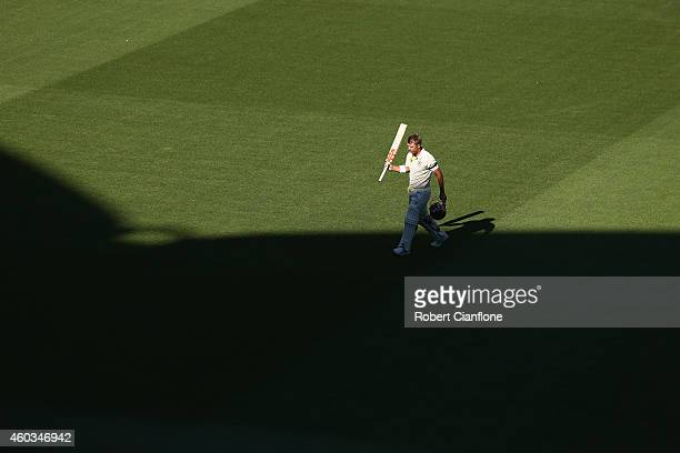 David Warner of Australia walks off the ground after he was dismissed during day four of the First Test match between Australia and India at Adelaide...