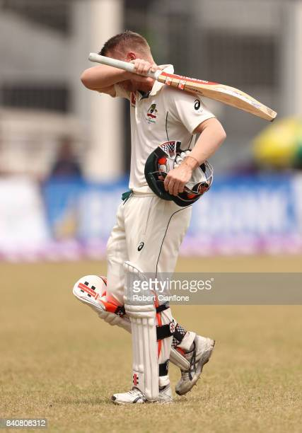 David Warner of Australia walks off the ground after he was dismissed by Shakib Al Hasan of Bangladesh during day four of the First Test match...