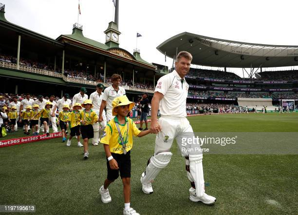 David Warner of Australia walks out onto the field during day one of the Third Test match in the series between Australia and New Zealand at Sydney...