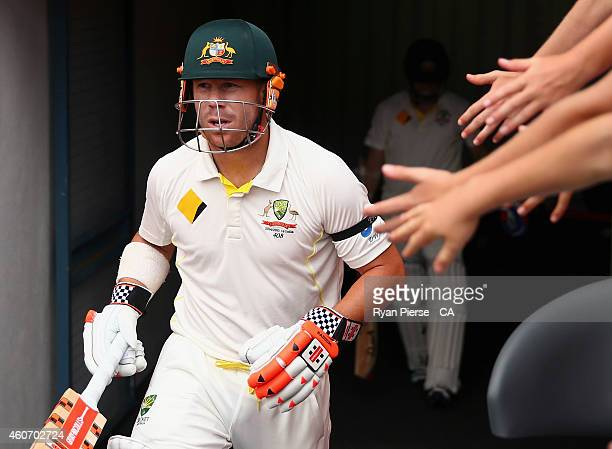 David Warner of Australia walks out to bat during day four of the 2nd Test match between Australia and India at The Gabba on December 20, 2014 in...