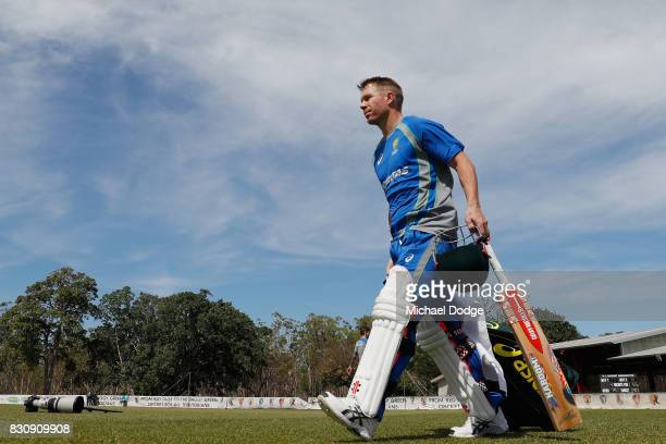 David Warner of Australia walks out to bat in the nets during an Australia Test cricket squad training session at Marrara Cricket Ground on August 13...