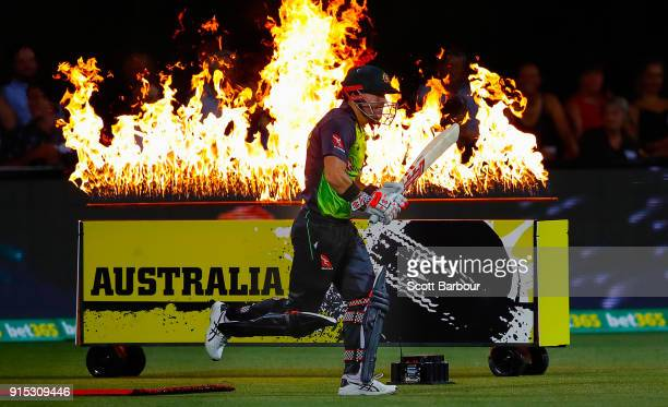David Warner of Australia walks out to bat through flames during the Twenty20 International match between Australia and England at Blundstone Arena...