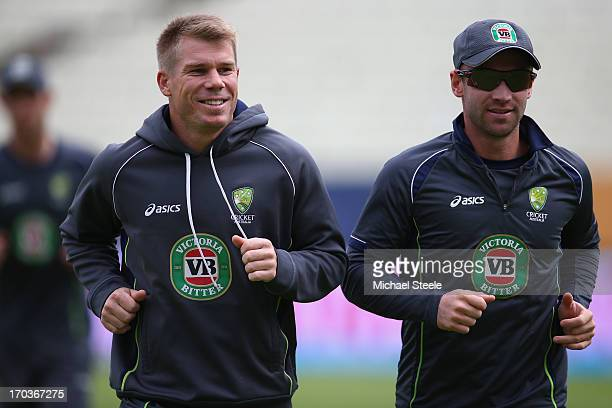 David Warner of Australia warms up pre match alongside Phil Hughes ahead of the ICC Champions Trophy Group A match between Australia and New Zealand...