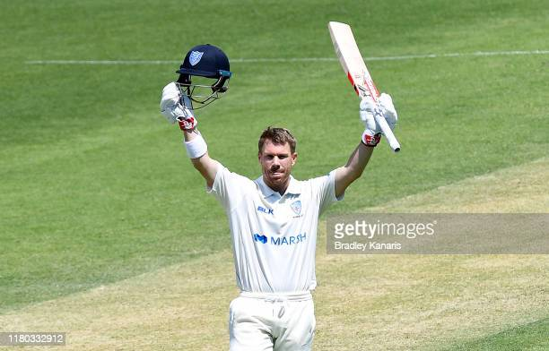 David Warner of New South Wales celebrates scoring a century during day two of the Sheffield Shield match between Queensland and New South Wales at...
