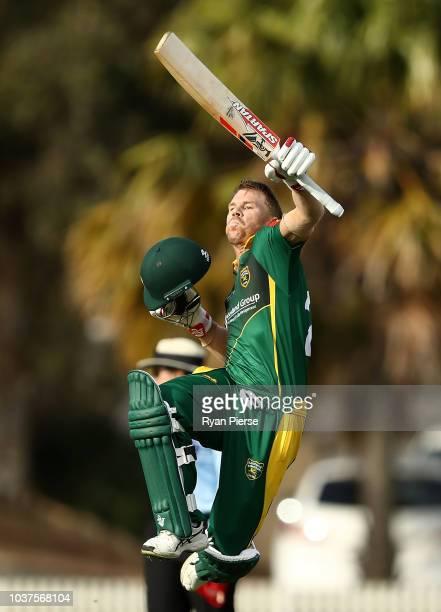 David Warner of Randwick Petersham celebrates after reaching his century during the NSW First Grade Club Cricket match between Randwick Petersham and...