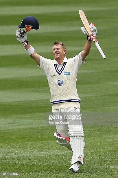 David Warner of the Blues celebrates his century during day two of the Sheffield Shield match between the Victoria Bushrangers and the New South...
