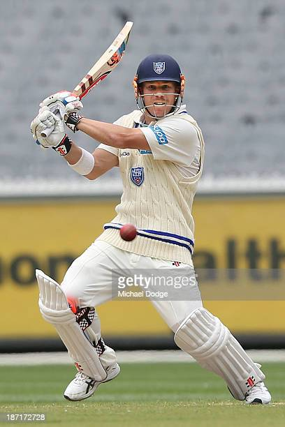 David Warner of the Blues hits the ball during day two of the Sheffield Shield match between the Victoria Bushrangers and the New South Wales Blues...