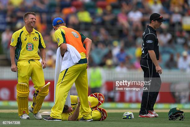 David Warner reacts after Steve Smith of Australia is hit in the groin by a ball during game two of the One Day International series between...