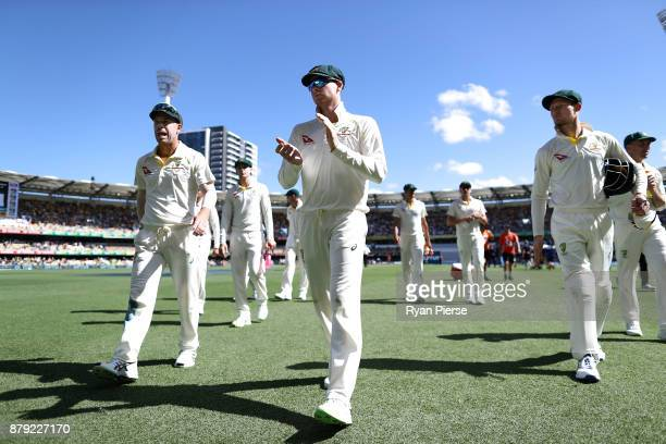 David Warner Steve Smith and Cameron Bancroft of Australia walk from the field after bowling England out during day four of the First Test Match of...